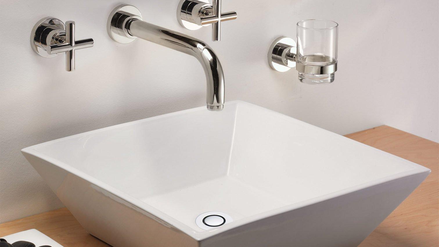Tiburon wall faucet with ZeroDrain in sink