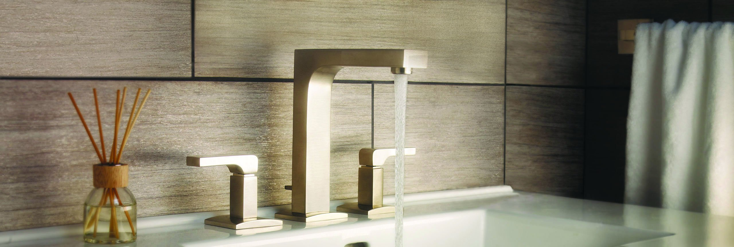 bathroom series Solimar widespread faucet in satin brass with running water
