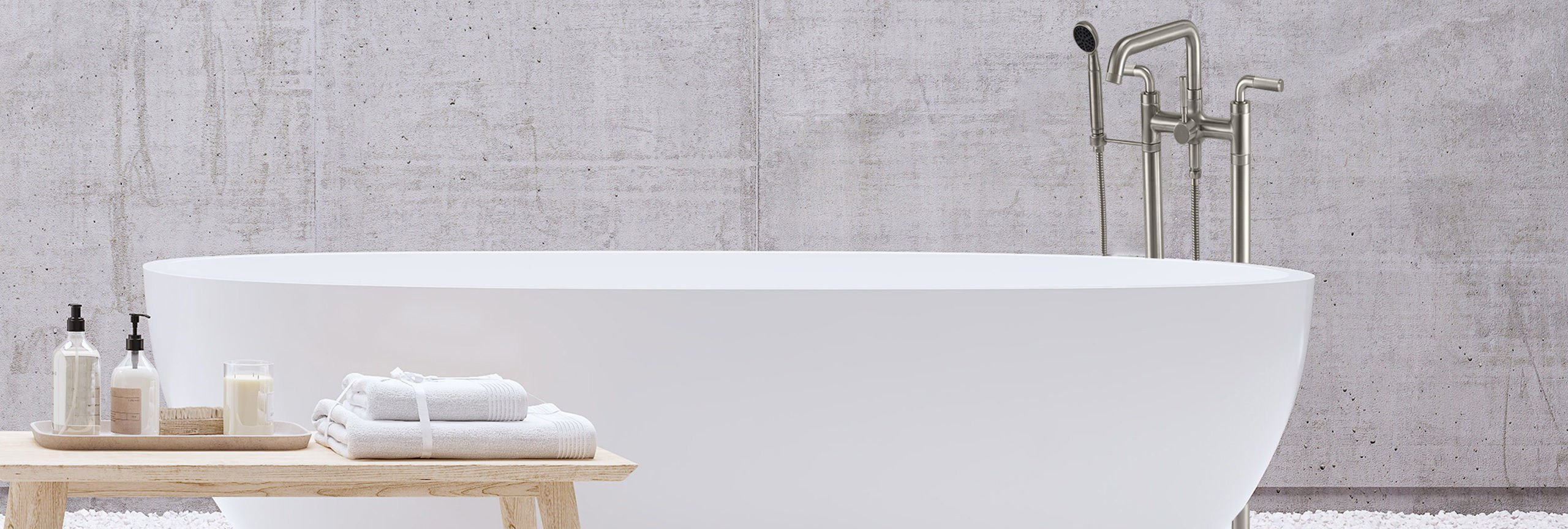 Descanso floor mount tub filler next to large white tub